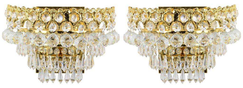 A PAIR OF GILT TONE AND CRYSTAL WALL SCONCES