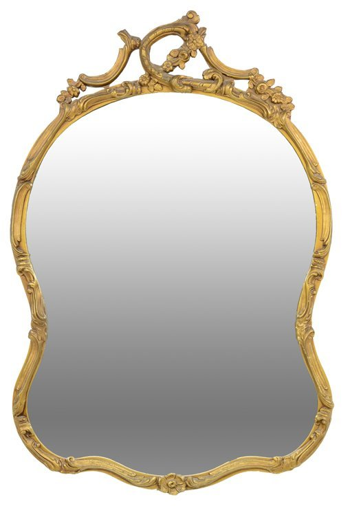 A ROCOCO GILT FINISHED SERPENTINE MIRROR WITH FLOWERS