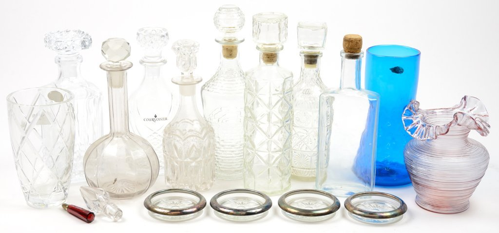 A COLLECTION OF VINTAGE CUT GLASS DECANTERS AND MORE