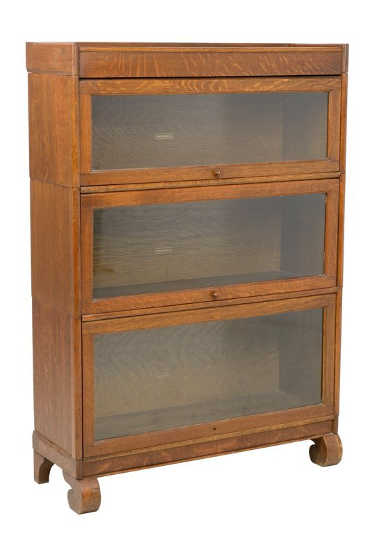 AN ANTIQUE TIGER STRIPE OAK BARRISTER BOOKCASE BY