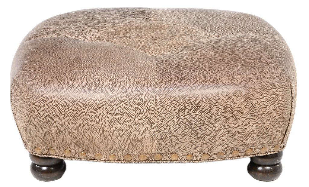A TUFTED LEATHER OTTOMAN ON TURNED FEET
