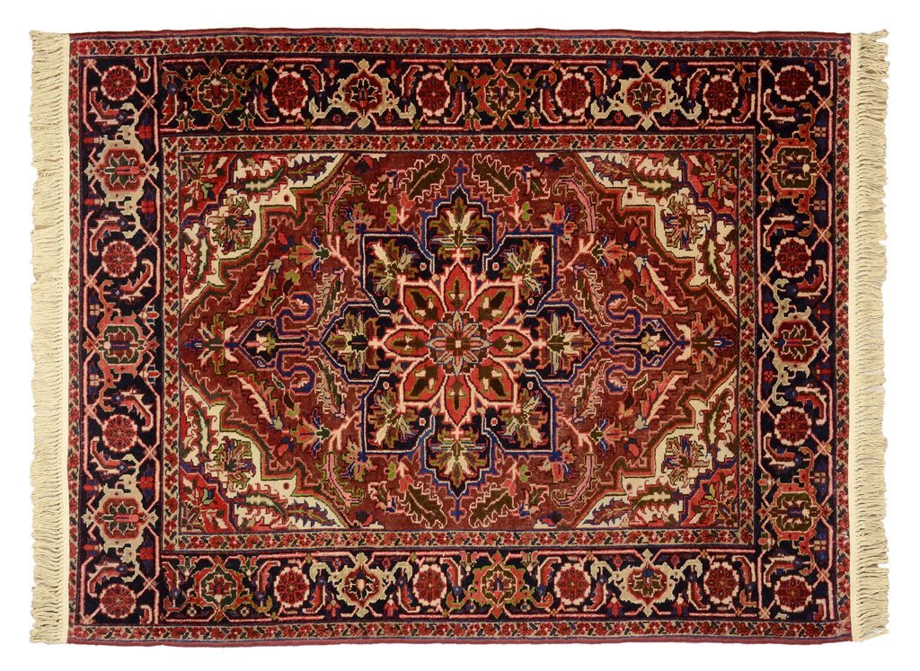 A PERSIAN HERIZ GHOROVAN CARPET WITH GEOMETRIC FLORET