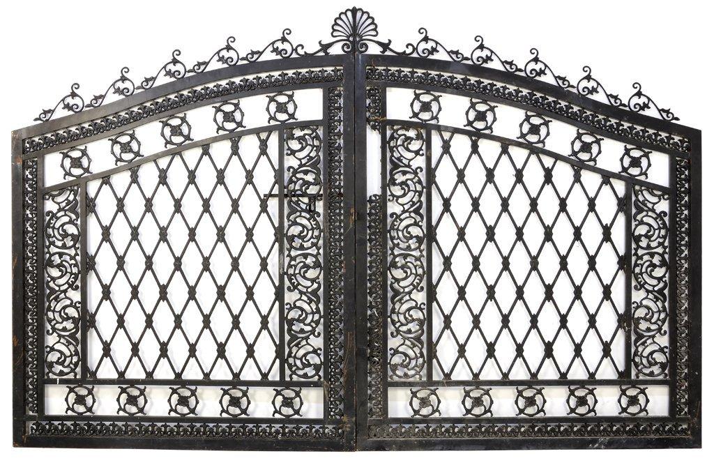 A PAIR OF IRON GATES WITH DIAMOND LATTICEWORK AND