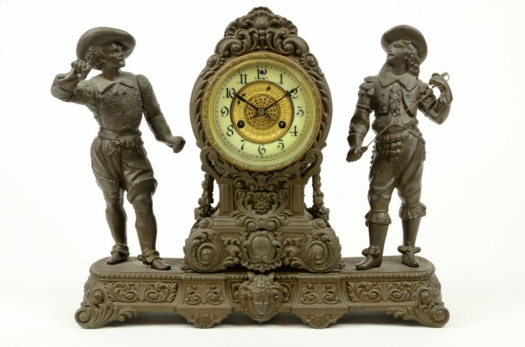 AN AMERICAN EMPIRE STYLE FIGURAL MANTEL CLOCK BY