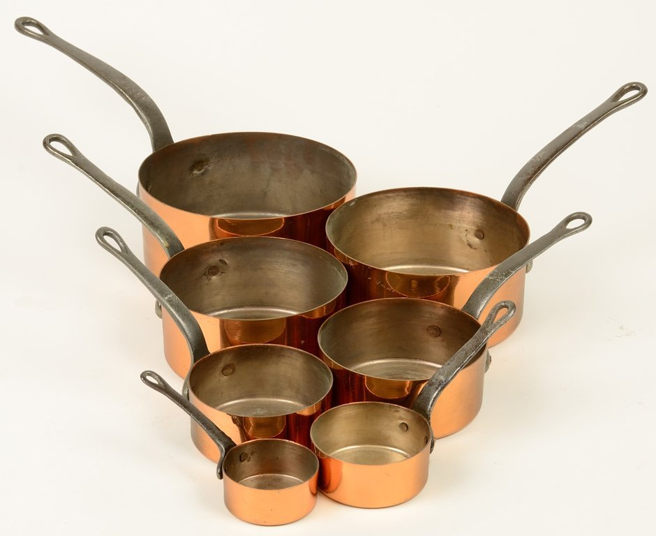 A SET OF SEVEN FRENCH CULINARY IRON-HANDLED DECORATIVE
