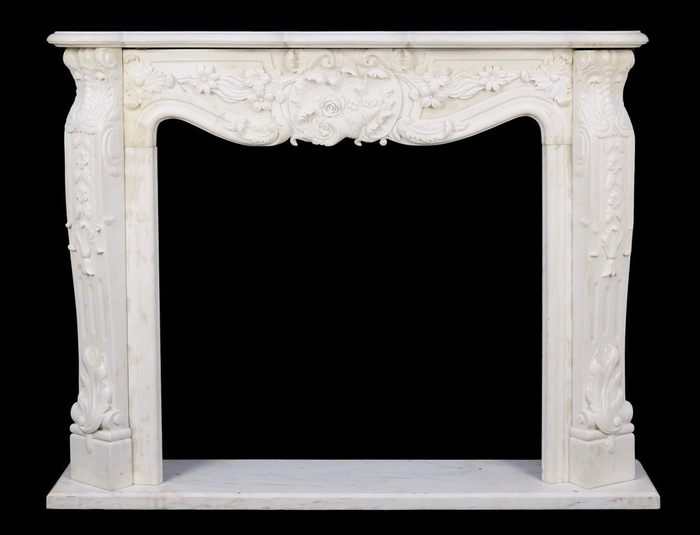 A WHITE MARBLE MANTEL WITH RELIEF CARVED FOLIATE AND