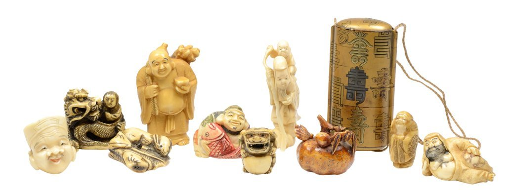 A COLLECTION OF NINE CARVED JAPANESE NETSUKES AND A
