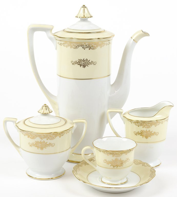 A HANDPAINTED NORITAKE DEMITASSE SET WITH SERVICE FOR