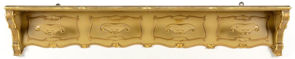 A CREAM AND GILT PAINTED HAT RACK WITH LATTICE DETAILS