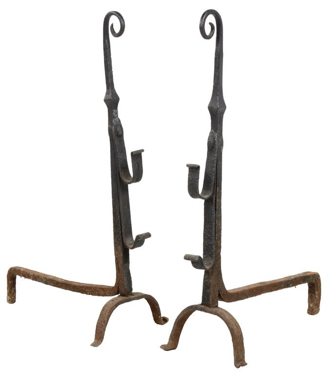 A PAIR OF ANTIQUE FRENCH CURLED TAIL ANDIRONS