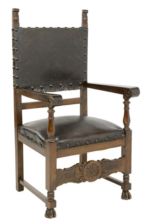 A RENAISSANCE REVIVAL STYLE ARMCHAIR WITH EMBOSSED
