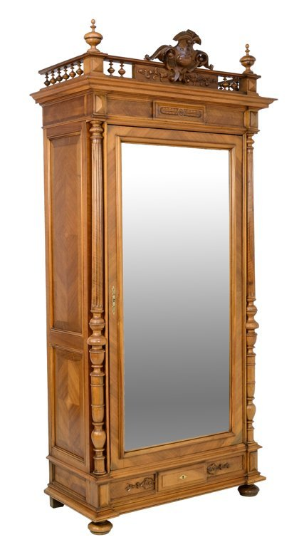 A HENRI II STYLE MIRRORED ARMOIRE WITH SHIELD IN A