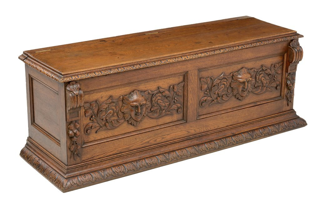 A VICTORIAN GOTHIC REVIVAL STYLE TRUNK WITH GREEN MAN