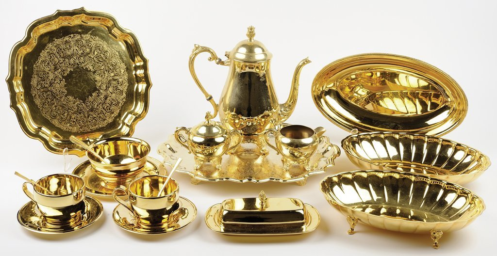 SIXTEEN GOLD PLATED SERVICE PIECES