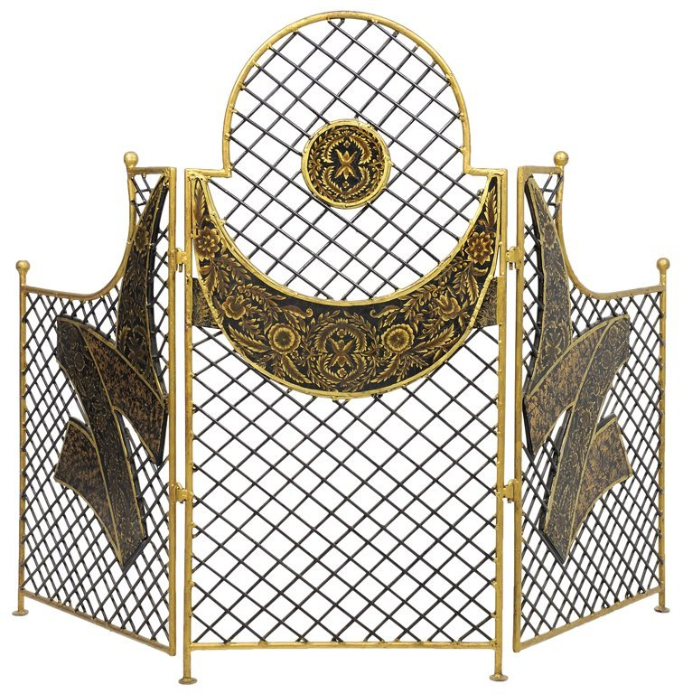 A BLACK AND PARCEL GILT METAL FIREPLACE SCRENE WITH
