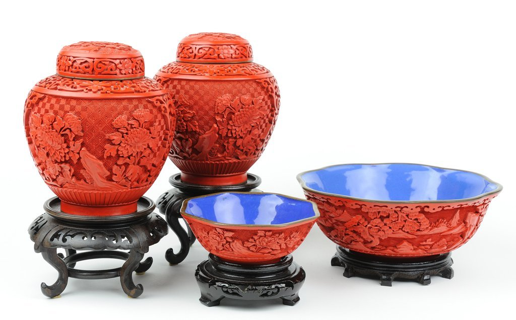 A COLLECTION OF FOUR CARVED RED LACQUER AND BLUE ENAMEL
