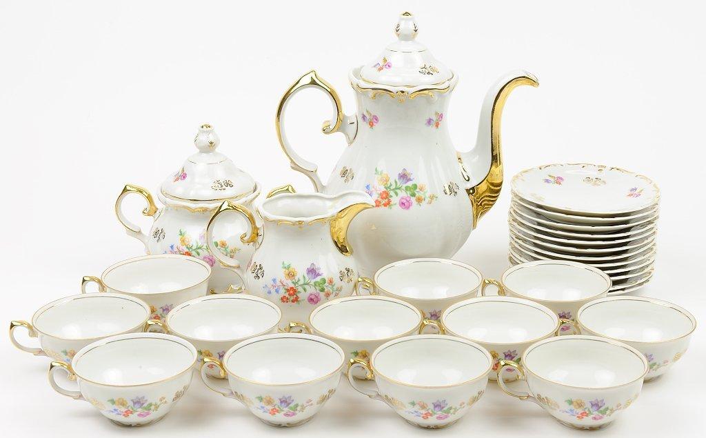 A DECORATIVE PORCELAIN TEA SERVICE FOR TWELVE