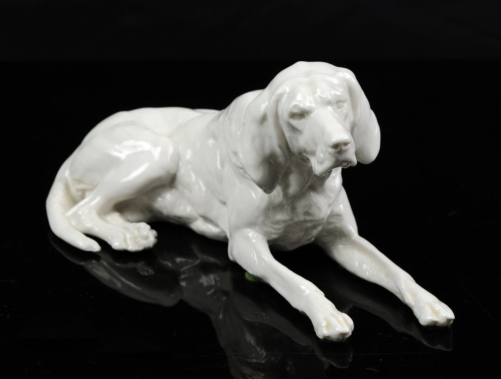 A NYMPHENBURG BLANC DE CHINE FIGURE OF A HUNTING HOUND