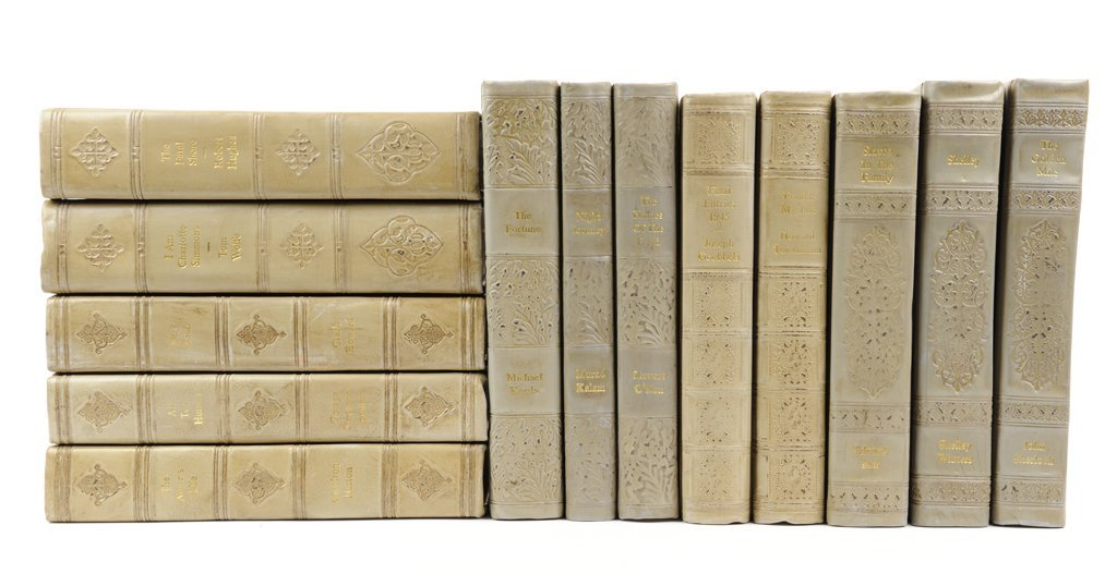A COLLECTION OF THIRTEEN TAUPE LEATHER BOUND DECORATIVE
