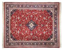 A HAND WOVEN BLUE AND RED INDIA TABRIZ RUG WITH DIAMOND