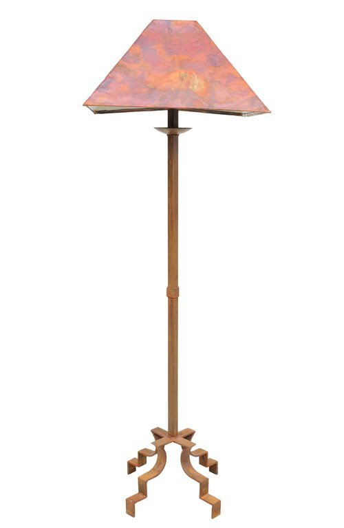A RUSTIC FLOOR LAMP WITH PIERCED COPPER SHADE