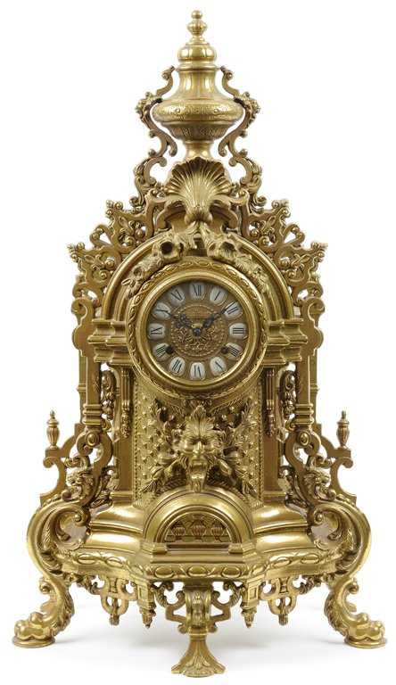 A French Rococo Style Gilt Metal Mantel Clock