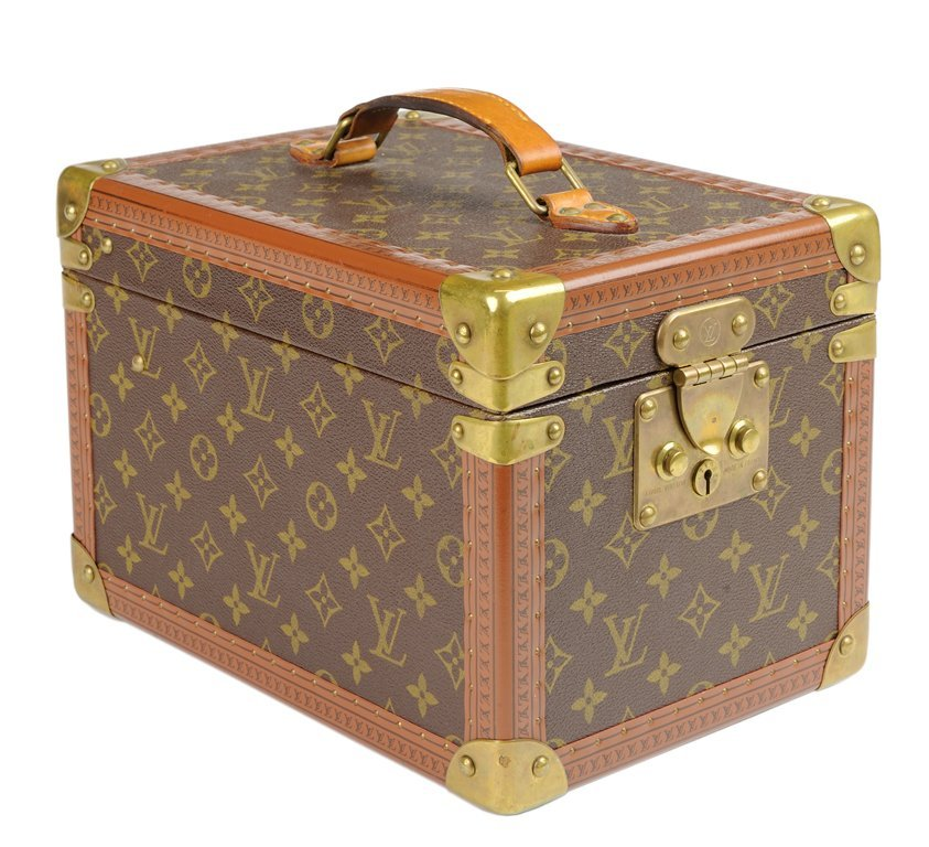 A LOUIS VUITTON MONOGRAM HARDSIDED COSMETIC CASE