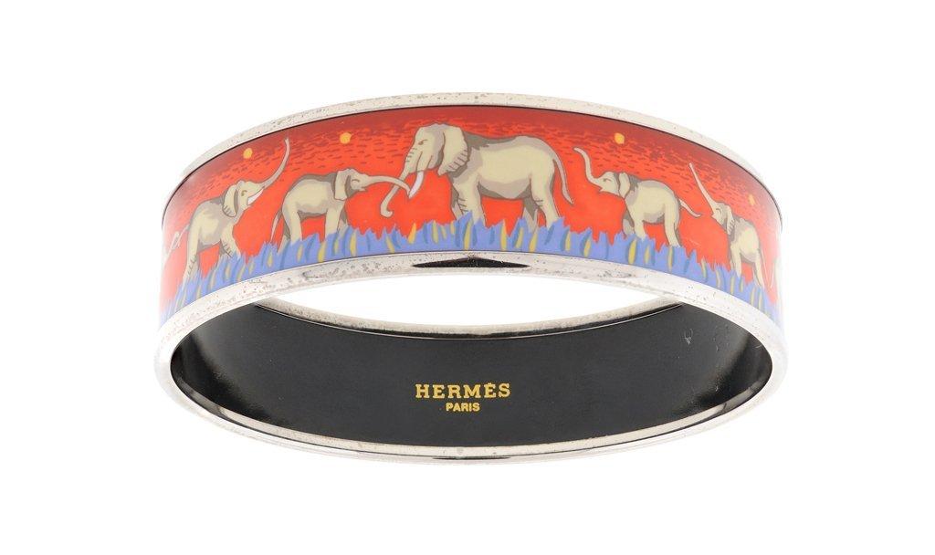 AN HERMÈS RED ENAMEL AND PALLADIUM BANGLE BRACELET