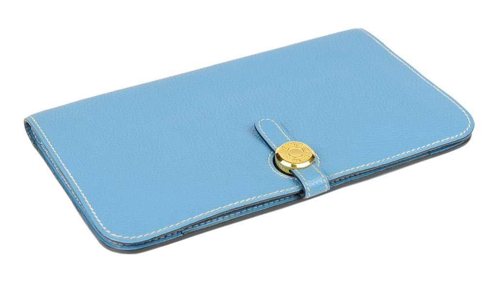 AN HERMÈS BLUE TOGO LEATHER DOGON WALLET AND
