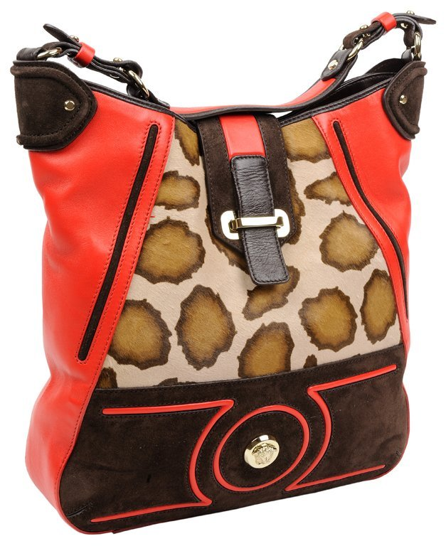 A VERSACE BROWN SUEDE AND RED LEATHER BAG