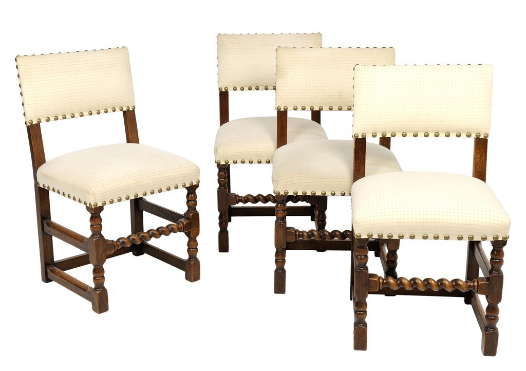 A SET OF FOUR FRENCH UPHOLSTERED OAK FARTHINGALE CHAIRS