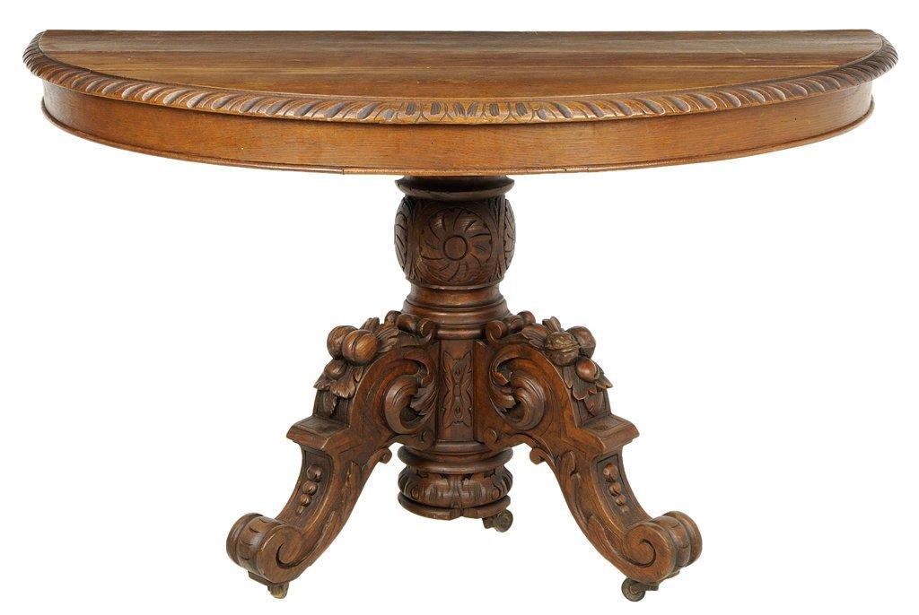 A FRENCH RENAISSANCE REVIVAL OAK CONSOLE TABLE