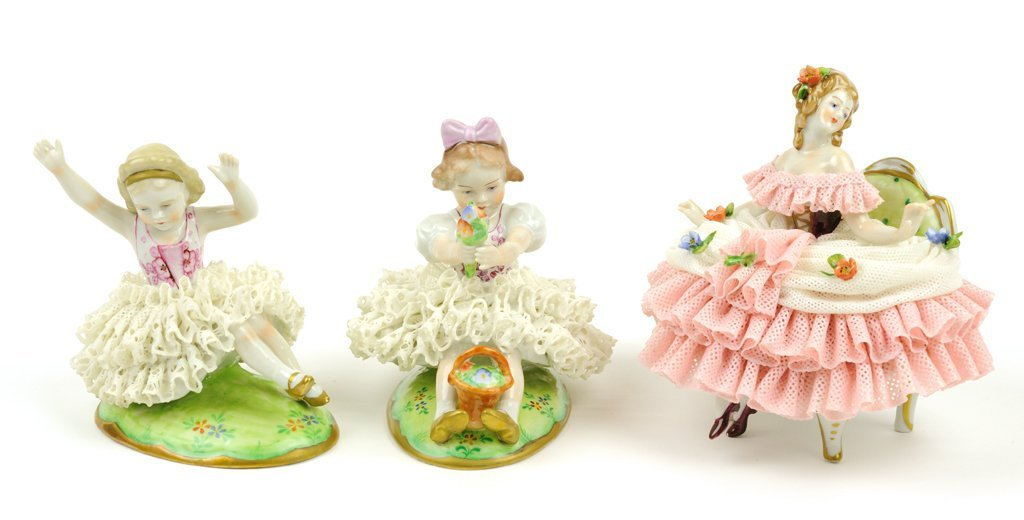 A GROUP OF THREE GERMAN PORCELAIN FIGURINES