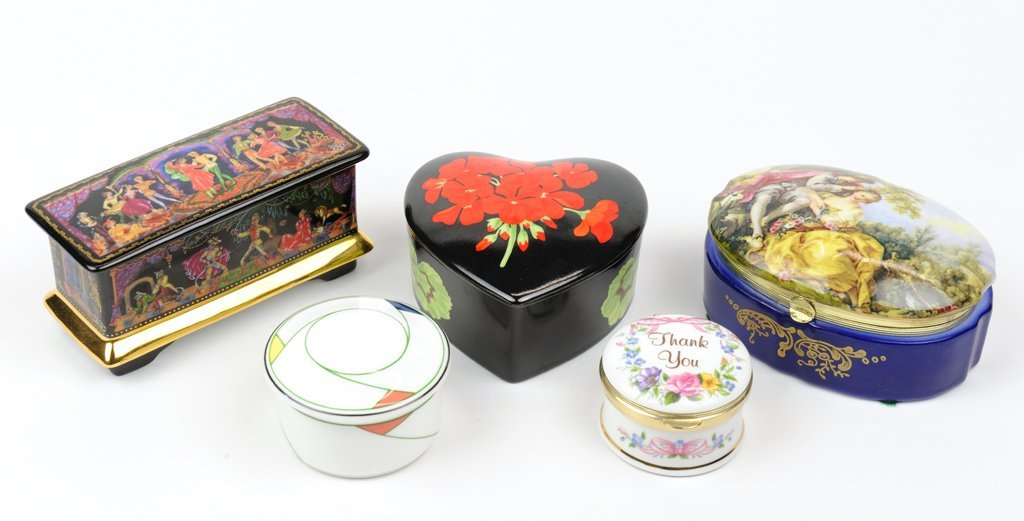 A GROUP OF FIVE PAINTED PORCELAIN BOXES
