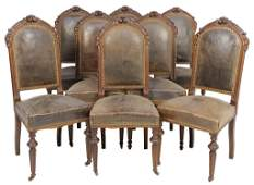 A SET OF EIGHT FRENCH LOUIS XVI STYLE DINING CHAIRS