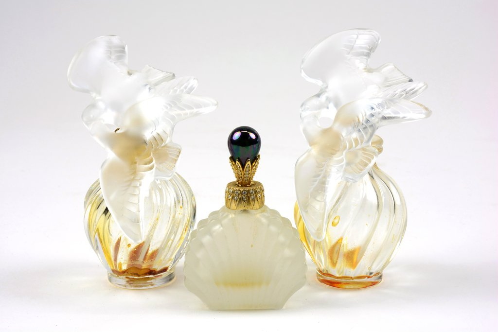 A GROUP OF THREE PERFUME BOTTLES