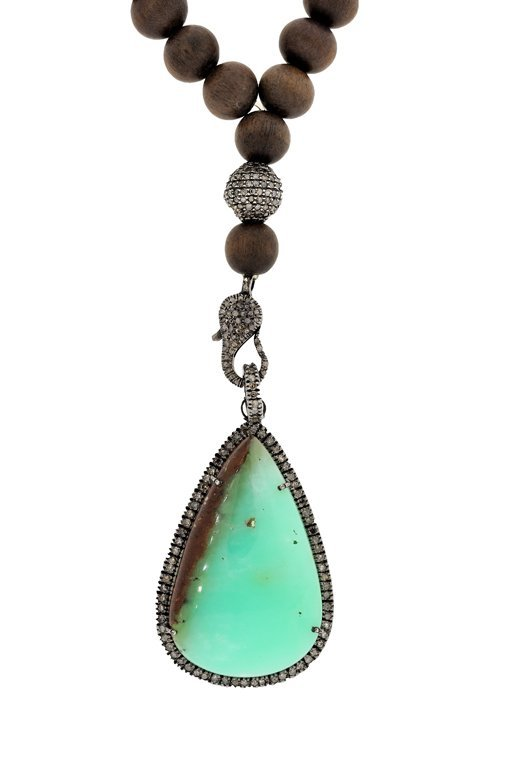 A TURQUOISE, STERLING SILVER, AND DIAMOND PENDANT ON A
