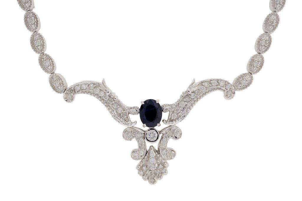 A LADY'S DESIGNER 14K WHITE GOLD SAPPHIRE & DIAMOND