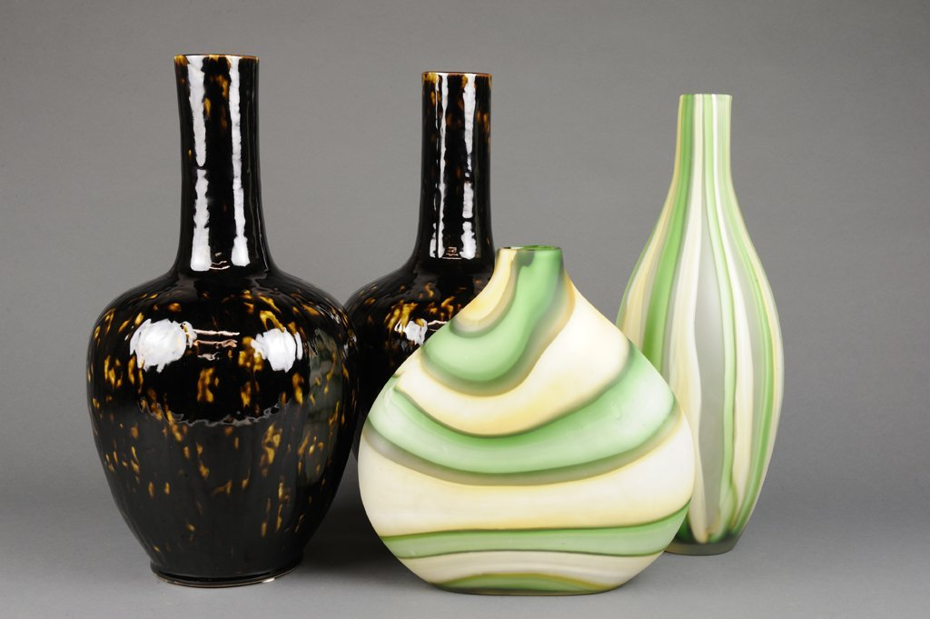 A GROUP OF FOUR DECORATIVE VASES