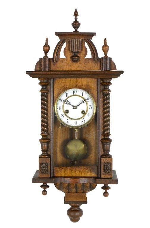 A FRENCH WALNUT WALL CLOCK