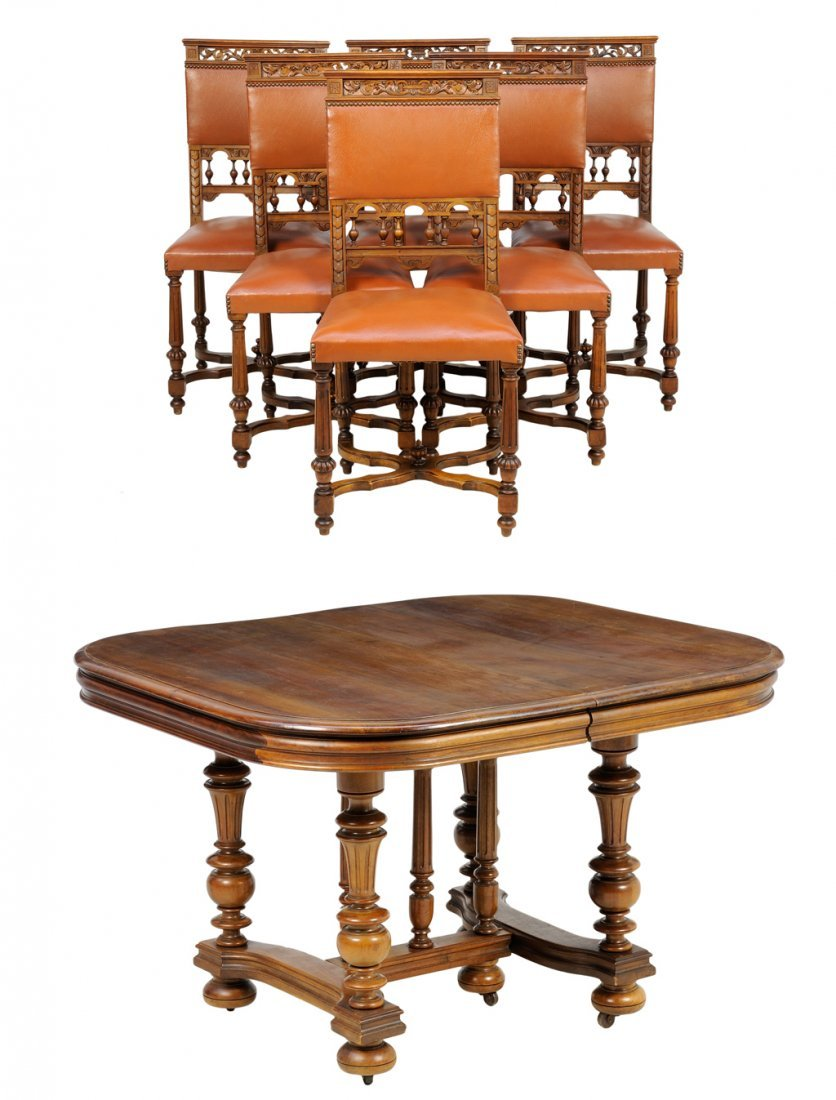 A RENAISSANCE REVIVAL WALNUT DINING TABLE & A SET OF