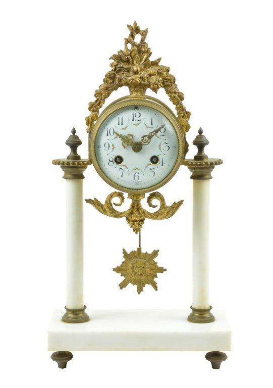 A FRENCH LOUIS XVI STYLE MANTEL CLOCK