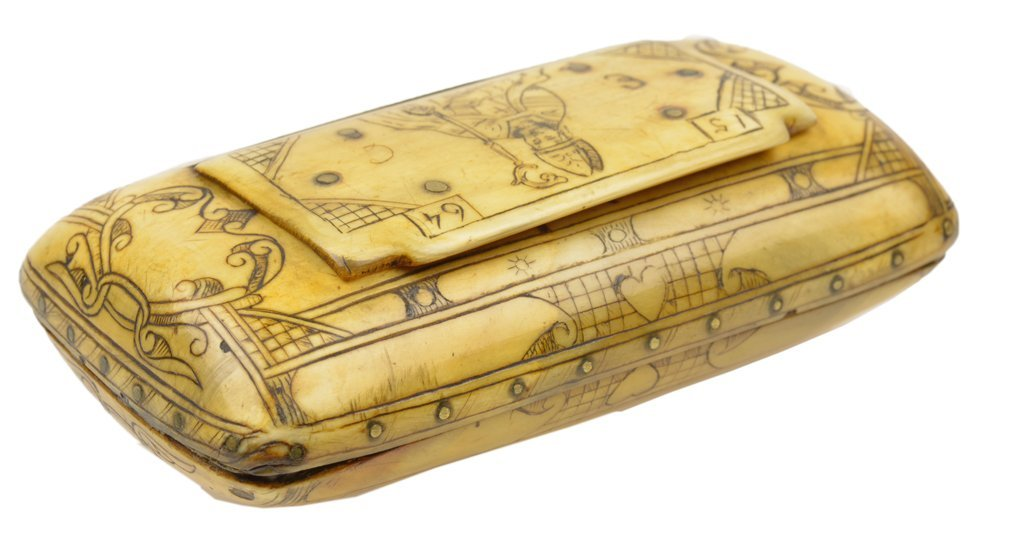 A CONTINENTAL CARVED IVORY SNUFF BOX