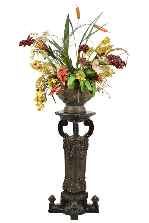 A CONTINENTAL STYLE BRONZED JARDINIERE ON STAND