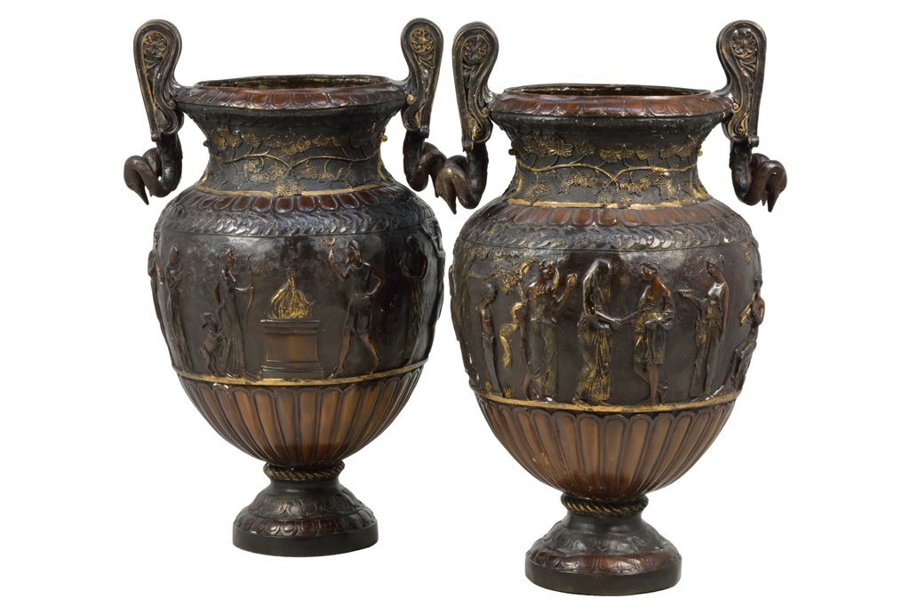 A PAIR OF CONTINENTAL STYLE PARCEL GILT BRONZED URNS