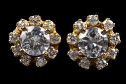 A PAIR OF 14 KARAT GOLD DIAMOND SOLITAIRE EARRINGS WITH