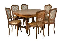 AN ASSEMBLED FRENCH PROVINCIAL STYLE DINING SET