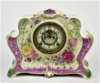 A ROYAL BONN ANSONIA PORCELAIN MANTEL CLOCK
