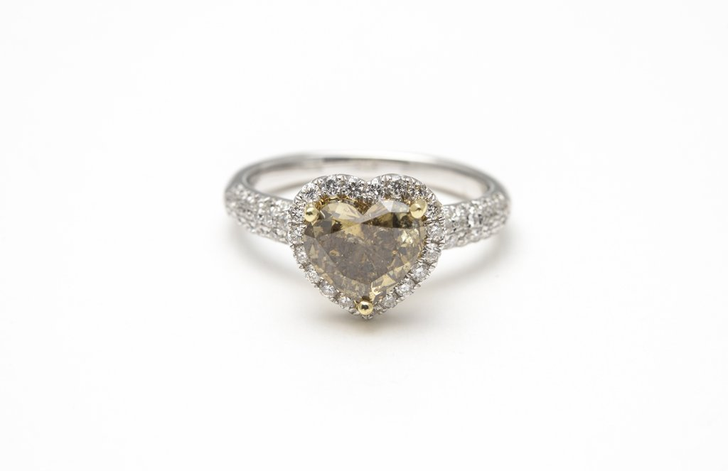 A HEART SHAPED FANCY COLOR DIAMOND RING