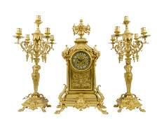 A LOUIS XV STYLE GILT BRONZE CLOCK GARNITURE